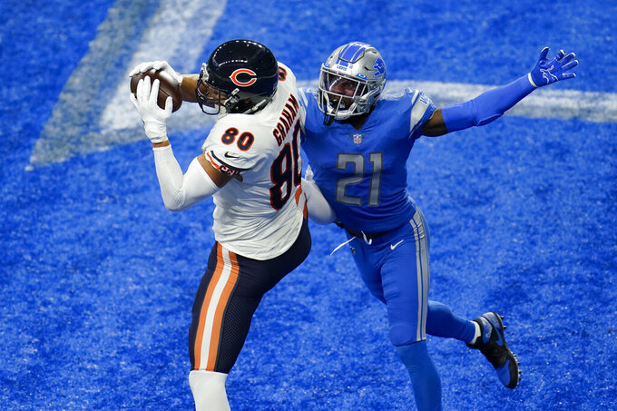Chicago Bears tight end Jimmy Graham (80) catches a two-yard touchdown pass as Detroit Lions defensive back Tracy Walker (21) defends in the second half of an NFL football game in Detroit, Sunday, Sept. 13, 2020. (AP Photo/Paul Sancya)