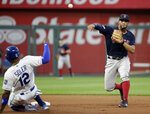 Boston Red Sox shortstop Xander Bogaerts throws to first for the double play hit into by Kansas City Royals' Kelvin Gutierrez after forcing Jorge Soler out at second to end the fourth inning of a baseball game Tuesday, June 4, 2019, in Kansas City, Mo. (AP Photo/Charlie Riedel)