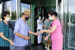 Two employees of the Ryugyong Health Complex disinfect the hands and check the fever of people coming to the complex to help curb the spread of the coronavirus, in Pyongyang, North Korea, Friday, July 31, 2020. (AP Photo/Jon Chol Jin)