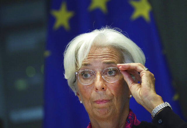 FILE  - In this Wednesday, Sept. 4, 2019 file photo, incoming President of the European Central Bank Christine Lagarde speaks to the European Parliament's Economic and Monetary Affairs Committee in Brussels.  Newly appointed European Central Bank head Christine Lagarde makes her first official assessment Thursday, Dec. 12, 2019 of the mixed bag that is the eurozone economy, which suffers from slowing manufacturing and global trade even as consumer spending helps prop up growth. (AP Photo/Francisco Seco, File)