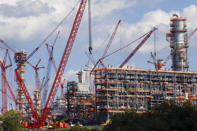 FILE —This file photo from Oct. 3, 2019 shows cranes as they work on construction of the Shell Pennsylvania Petrochemicals Complex and ethylene cracker plant located in Potter Township, Pa. Under mounting pressure from state and local officials, Shell announced it is suspending construction at its massive manufacturing complex in western Pennsylvania. The company said Wednesday, March, 18, 2020 that it's temporarily halting work at its soon-to-be-completed plant which will turn the area's vast natural gas deposits into plastics. The shutdown takes effect immediately. (AP Photo/Keith Srakocic, File)