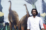 In this Nov. 19, 2019, photo, Behrouz Boochani, the Kurdish film-maker, writer and refugee who has documented life inside the Australian offshore immigration camp on Manus Island, poses for a portrait in Christchurch, New Zealand. (AP Photo/Mark Baker)