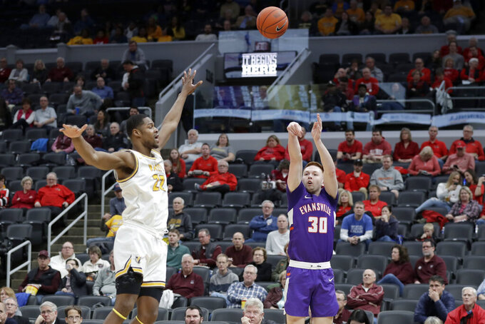 Evansville's Noah Frederking (30) makes a 3-point basket over Valparaiso's Mileek McMillan (22) during the first half of an NCAA college basketball game in the first round of the Missouri Valley Conference men's tournament Thursday, March 5, 2020, in St. Louis. (AP Photo/Jeff Roberson)