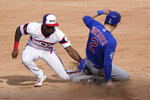 Chicago White Sox shortstop Tim Anderson, left, tags out Chicago Cubs' Nico Hoerner at second during the sixth inning of a baseball game in Chicago, Sunday, Sept. 27, 2020. Nico Hoerner caught stealing second base. (AP Photo/Nam Y. Huh)