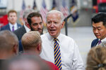 President Joe Biden greets people after delivering a speech during a visit to the Lehigh Valley operations facility for Mack Trucks in Macungie, Pa., Wednesday, July 28, 2021. (AP Photo/Susan Walsh)
