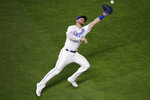 Kansas City Royals right fielder Hunter Dozier can't catch an RBI triple by New York Mets' Juan Lagares during the eighth inning of a baseball game Saturday, Aug. 17, 2019, in Kansas City, Mo. (AP Photo/Charlie Riedel)