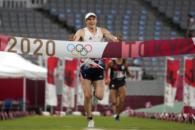 Joseph Choong of Britain crosses the finish line to win the men's modern pentathlon at the 2020 Summer Olympics, Saturday, Aug. 7, 2021, in Tokyo, Japan. (AP Photo/Hassan Ammar)
