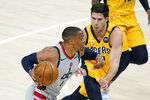 Washington Wizards' Russell Westbrook (4) goes to the basket against Indiana Pacers' Doug McDermott (20) during the first half of an NBA basketball game Saturday, May 8, 2021, in Indianapolis. (AP Photo/Darron Cummings)