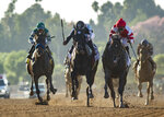 In a photo provided by Benoit Photo, Omaha Beach and jockey Mike Smith, right front, overpower Shancelot, second from left, with Emisael Jaramillo, and Flagstaff, left, with Victor Espinoza, to win the Grade I, $300,000 Santa Anita Sprint Championship horse race Saturday, Oct. 5, 2019, at Santa Anita in Arcadia, Calif.(Benoit Photo via AP)