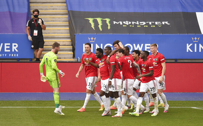 Manchester United's Jesse Lindgard celebrates with teammates after scoring his side's second goal during the English Premier League soccer match between Leicester City and Manchester United at the King Power Stadium, in Leicester, England, Sunday, July 26, 2020. (Oli Scarff/Pool via AP)