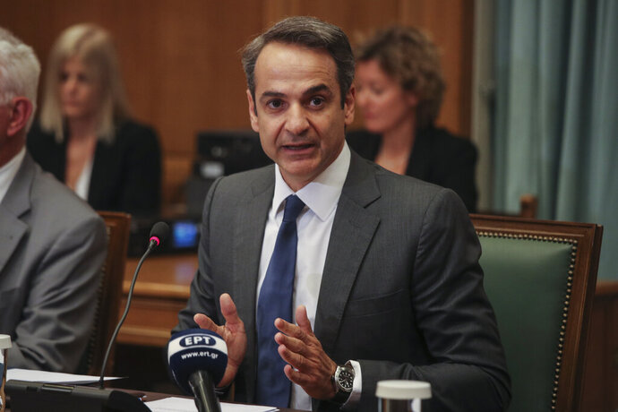 Greek Prime Ministers Kyriakos Mitsotakis speaks as new government participate on the first cabinet meeting, in Athens, on Wednesday, July 10, 2019. Greece's new prime minister, Kyriakos Mitsotakis, has chaired his Cabinet's first meeting, vowing to change the system of governance so as to improve the daily lives of Greeks and urging his ministers to lead by example.(AP Photo/Petros Giannakouris)