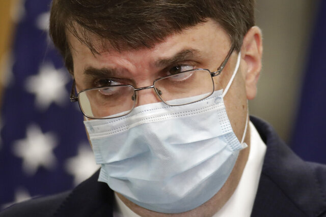 Robert Wilkie, secretary of Veterans Affairs, talks to reporters after touring the Kansas City VA Medical Center, Thursday, July 2, 2020, in Kansas City, Mo. Civil rights organizations are pushing for changes at the hospital after numerous complaints from Black employees about harassment and discrimination. (AP Photo/Charlie Riedel)