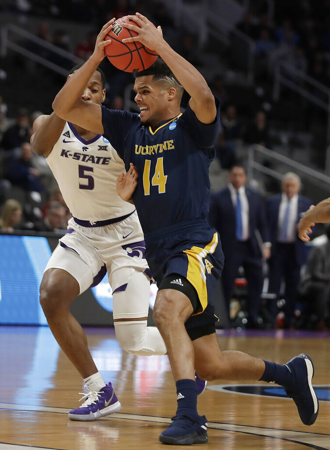 UC Irvine guard Evan Leonard (14) drives past Kansas State guard Barry Brown Jr. (5) during the first half of a first-round game in the NCAA men's college basketball tournament, Friday, March 22, 2019, in San Jose, Calif. (AP Photo/Ben Margot)