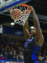 Buffalo forward Nick Perkins dunks during the first half of an NCAA college basketball game against Kent State, Friday, Jan. 25, 2019, in Kent, Ohio. (AP Photo/David Dermer)