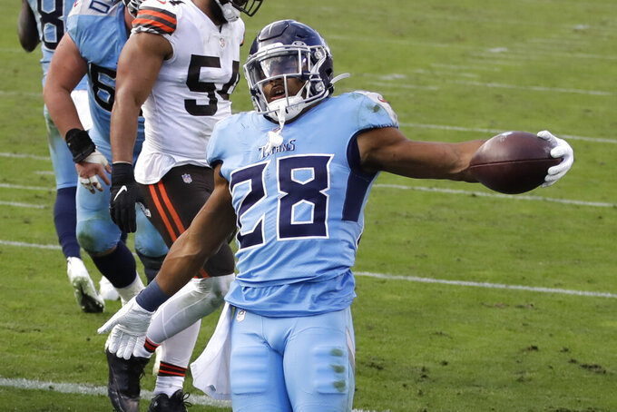 Tennessee Titans running back Jeremy McNichols (28) celebrates after scoring a touchdown against the Cleveland Browns in the second half of an NFL football game Sunday, Dec. 6, 2020, in Nashville, Tenn. (AP Photo/Ben Margot)