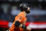 San Francisco Giants' Brandon Belt watches his two-run home run off San Diego Padres' Dinelson Lamet during the first inning of a baseball game Friday, Aug. 30, 2019, in San Francisco. (AP Photo/Ben Margot)