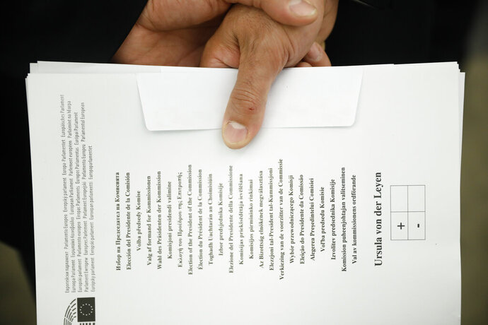An usher holds a ballot to be used for the election of the German candidate Ursula von der Leyen as the new European Commission President at the European Parliament in Strasbourg, eastern France, Tuesday, July 16, 2019. (AP Photo/Jean-Francois Badias)