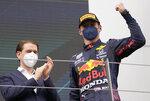 Austrian Chancellor Sebastian Kurz, left, applauds to winner Red Bull driver Max Verstappen of the Netherlands after the Styrian Formula One Grand Prix at the Red Bull Ring racetrack in Spielberg, Austria, Sunday, June 27, 2021. (AP Photo/Darko Vojinovic)