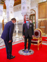 In this photo released by the Royal Palace, Morocco's King Mohammed VI, right, receives Aziz Akhannouch the president of the National Rally of Independents party (RNI), winner of the legislative elections at the Royal Palace in Fez, Morocco, Friday, Sept. 10, 2021. The monarch has charged the new head of state to constitute the new government. (Moroccan Royal Palace via AP)