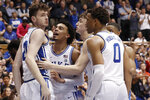 Duke forward Matthew Hurt, left, is congratulated following a basket against Florida State by guard Tre Jones, guard Alex O'Connell, and forward Wendell Moore Jr. (0) during the second half of an NCAA college basketball game in Durham, N.C., Monday, Feb. 10, 2020. (AP Photo/Gerry Broome)