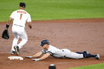 New York Yankees' Brett Gardner slides into second with a double during the third inning of a baseball game, next to Baltimore Orioles shortstop Richie Martin on Wednesday, May 22, 2019, in Baltimore. (AP Photo/Nick Wass)