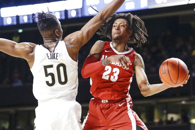 Alabama guard John Petty Jr. (23) passes around Vanderbilt forward Ejike Obinna (50) in the second half of an NCAA college basketball game Wednesday, Jan. 22, 2020, in Nashville, Tenn. Alabama won 77-62. (AP Photo/Mark Humphrey)
