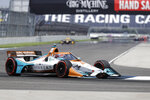 Race driver Colton Herta drives through a turn during the IndyCar auto race at Indianapolis Motor Speedway in Indianapolis, Saturday, July 4, 2020. (AP Photo/Darron Cummings)