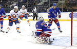 New York Islanders' Josh Bailey (12) celebrates a second-period goal by teammate Anthony Beauvillier (not shown) against New York Rangers' Igor Shesterkin (31) during an NHL hockey game Thursday, April 29, 2021, in New York. (Bruce Bennett/Pool Photo via AP)