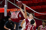 Utah guard Pelle Larsson, rear, lays the ball up as Stanford forward Jaiden Delaire (11) defends in the second half during an NCAA college basketball game Thursday, Jan. 14, 2021, in Salt Lake City. (AP Photo/Rick Bowmer)