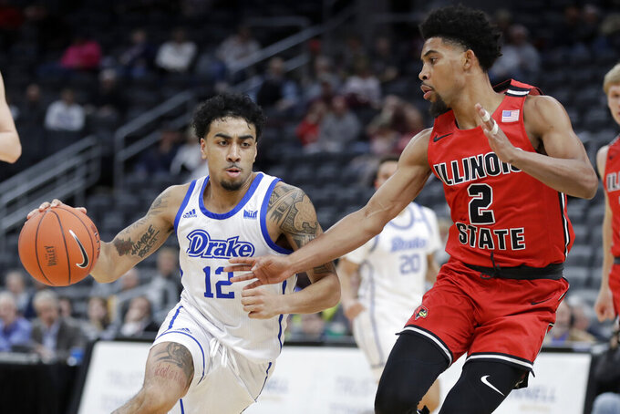 Drake's Roman Penn (12) drives past Illinois State's Zach Copeland (2) during the first half of an NCAA college basketball game in the first round of the Missouri Valley Conference men's tournament Thursday, March 5, 2020, in St. Louis. (AP Photo/Jeff Roberson)