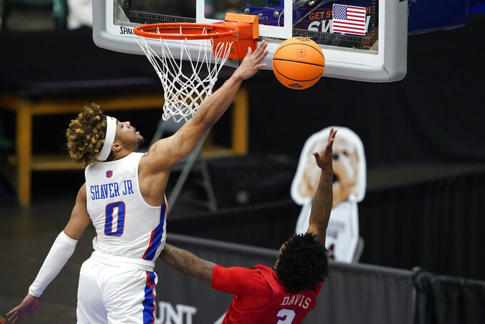 Boise State guard Marcus Shaver Jr. (0) blocks a shot by SMU guard Kendric Davis, right, during the first half of an NCAA college basketball game in the first round of the NIT, Thursday, March 18, 2021, in Frisco, Texas. (AP Photo/Tony Gutierrez)