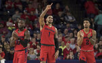 Dayton players ,Jalen Crutcher( 10), Obi Toppin (0) and Ibi Watson (2) celebrate after defeating Richmond in an NCAA college basketball game in Richmond, Va., Saturday, Jan. 25, 2020. (AP Photo/Lee Luther Jr.)