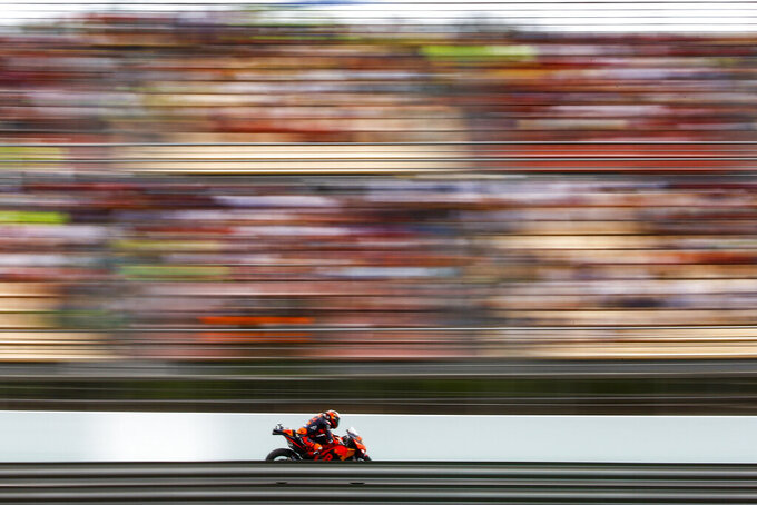 Portugal's Miguel Oliveira of KTM on his way to win the Catalunya Motorcycle Grand Prix at the Barcelona Catalunya racetrack in Montmelo, near Barcelona, Spain, Sunday, June 6, 2021. (AP Photo/Joan Monfort)