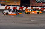 Denny Hamlin (11) races ahead of Daniel Suarez (41) during a NASCAR Cup Series auto race on Sunday, Sept. 1, 2019, at Darlington Raceway in Darlington, S.C. (AP Photo/Richard Shiro)
