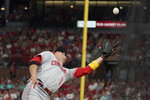 Cincinnati Reds first baseman Joey Votto catches a foul ball by St. Louis Cardinals' Yadier Molina during the sixth inning of a baseball game Friday, Sept. 10, 2021, in St. Louis. (AP Photo/Jeff Roberson)