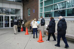 People line up at Nassau County's first COVID-19 vaccination distribution site, set up by Northwell Health and Nassau County, at Nassau County Community College, Tuesday, Jan. 5, 2021, in Garden City, N.Y. Eligible health care and front line workers were the first people in the county able to get the vaccine. (AP Photo/Kathy Willens)