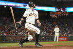 San Francisco Giants' Brandon Belt watches his home run against the San Diego Padres during the seventh inning of a baseball game in San Francisco, Wednesday, Sept. 15, 2021. (AP Photo/Jeff Chiu)