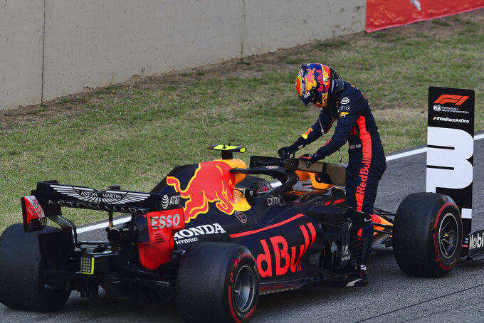 Red Bull driver Alexander Albon of Thailand leaves his car after placing third at the Formula One Grand Prix of Tuscany, at the Mugello circuit in Scarperia, Italy, Sunday, Sept. 13, 2020. (Claudio Giovannini, Pool via AP)