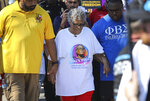 Opal Lee, 94, walks towards downtown Fort Worth, Texas from Evans Avenue Plaza during the first nationally recognized Juneteenth holiday on Saturday, June 19, 2021. Lee makes the 2.5-mile walk to symbolize the two and a half years it took for slaves in Texas to realize they had been freed. (Amanda McCoy/Star-Telegram via AP)
