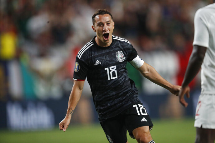 Mexico midfielder Andres Guardado reacts after scoring a goal against Canada during the second half of a CONCACAF Gold Cup soccer match Wednesday, June 19, 2019, at Mile High Stadium in Denver. Mexico won 3-1. (AP Photo/David Zalubowski)