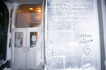 In this Feb. 13, 2019, photo, the names of two lovers are etched onto a snow-covered wall of the United States Post Office and Court House in Nome, Alaska. (AP Photo/Wong Maye-E)