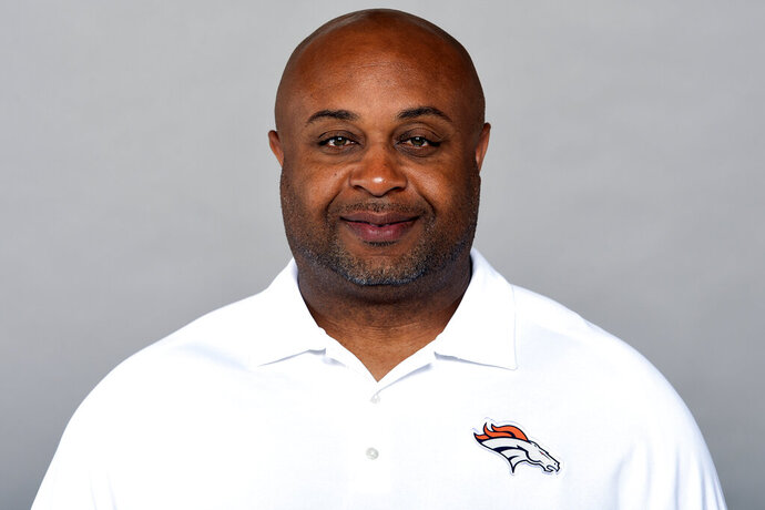 This is a 2019 photo of Curtis Modkins of the Denver Broncos NFL football team. Modkins has tested positive for COVID-19 and won't accompany the team on its trip to New England. The Broncos said they learned of Modkins' diagnosis early Saturday, Oct. 17, 2020. (AP Photo/File)