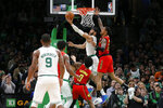 Boston Celtics forward Jayson Tatum (0) drives to the basket ahead of Atlanta Hawks forward John Collins (20) during the second half of an NBA basketball game Friday, Feb. 7, 2020, in Boston. (AP Photo/Mary Schwalm)