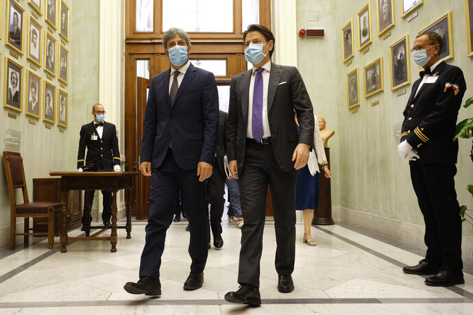 President of the Chamber of Deputies Roberto Fico, left, and Italian Premier Giuseppe Conte leave after listening to ISTAT's (Italian National Institute of Statistics) annual report, in Rome, Friday, July 3, 2020. One of Italy's highest institutional leaders has slammed Egypt's stance in a probe to bring to justice the torturers and killers of an Italian doctoral student in Cairo. Roberto Fico, president of the Parliament's lower Chamber of Deputies, told Italian state TV on Friday that lack of satisfactory cooperation from Egyptian prosecutors amounted to a ''punch in the face″ of Italy.  (Mauro Scrobogna/LaPresse via AP)
