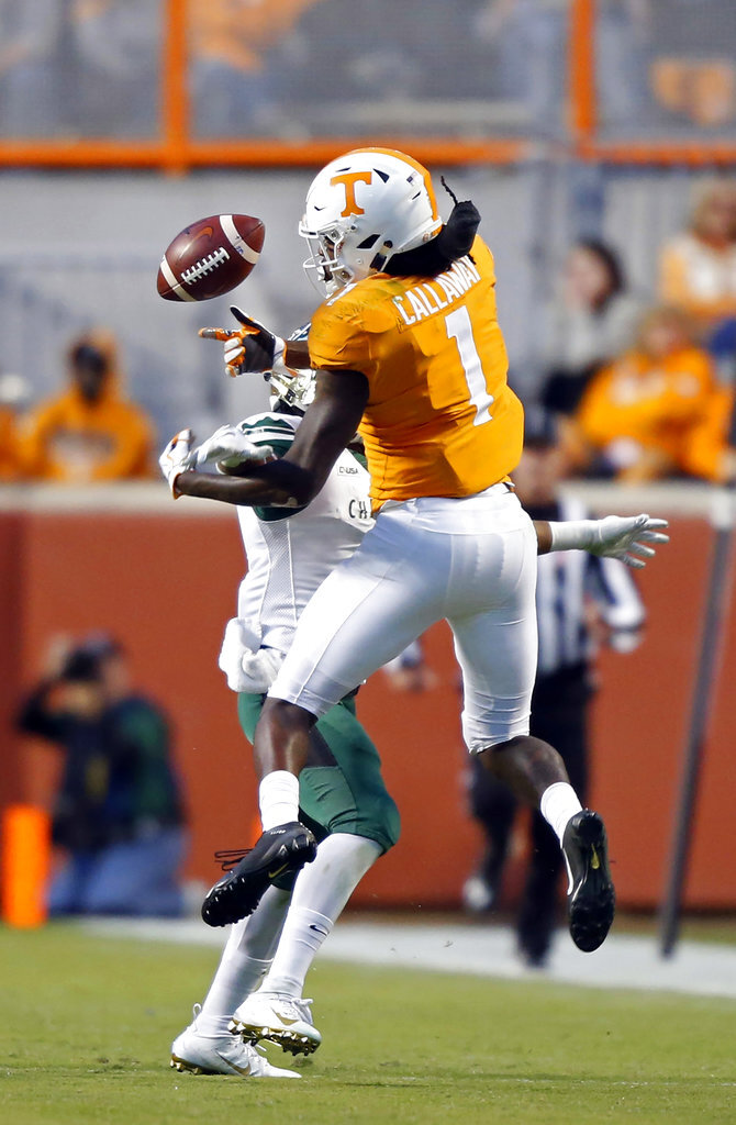 Tennessee wide receiver Marquez Callaway (1) loses control of the ball as he's hit by a Charlotte defender in the second half of an NCAA college football game Saturday, Nov. 3, 2018, in Knoxville, Tenn. Tennessee won 14-3. (AP Photo/Wade Payne)