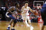 Nebraska's Isaiah Roby (15) drives past Penn State's Mike Watkins (24) during the first half of an NCAA college basketball game in Lincoln, Neb., Thursday, Jan. 10, 2019. (AP Photo/Nati Harnik)