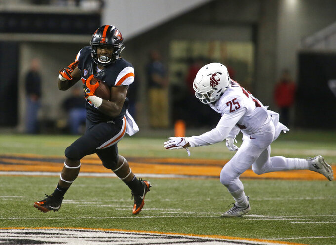 Oregon State running back Jermar Jefferson (22) pulls away from Washington State's Skyler Thomas (25) during the second half of an NCAA college football in Corvallis, Ore., Saturday, Oct. 6, 2018. (AP Photo/Timothy J. Gonzalez)