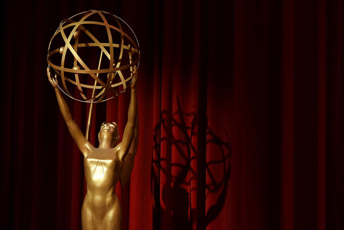 FILE - In this July 12, 2018, file photo, an Emmy statue is displayed onstage at the 70th Primetime Emmy Nominations Announcements at the Television Academy's Saban Media Center, in Los Angeles. The Emmy Awards being held on Sunday, Sept. 20, 2020, will include a $2.8 million donation to No Kid Hungry to support the group's efforts to feed children affected by the coronavirus pandemic. The Television Academy announced the donation Friday, Sept. 18. (Photo by Chris Pizzello/Invision/AP, File)