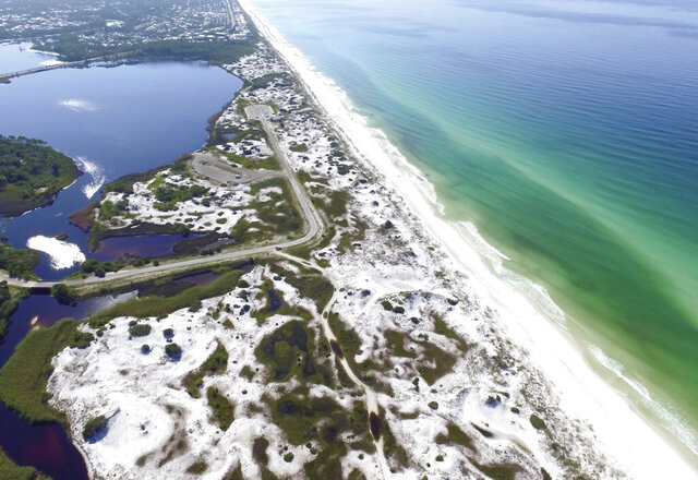 This Aug. 1, 2018, aerial photo made available by the Florida Department of Environmental Protection shows Grayton Beach State Park in Santa Rosa Beach, Fla. The beach earned the first spot of top U.S beaches according to Florida International University professor Stephen Leatherman. The beach was chosen in part because of its sugar-white sand and its clear, emerald-green water. (Running Man Pictures/Courtesy of Florida Department of Environmental Protection via AP)