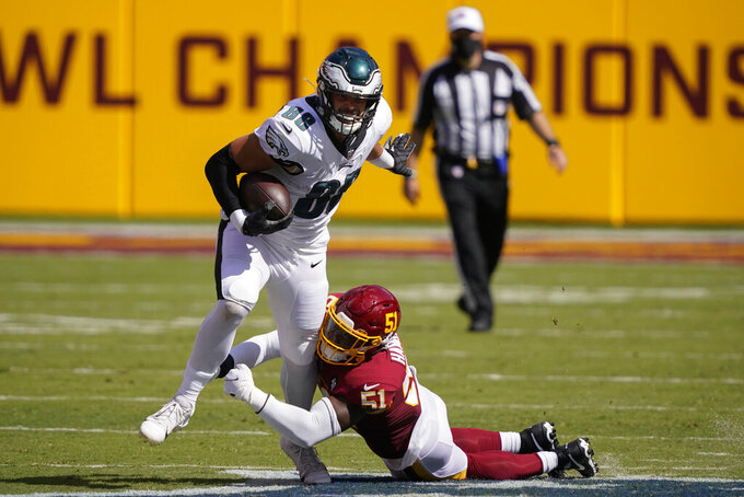Philadelphia Eagles tight end Dallas Goedert (88) tries to break away from a tackle by Washington Football Team linebacker Shaun Dion Hamilton (51) during the second half of an NFL football game, Sunday, Sept. 13, 2020, in Landover, Md. (AP Photo/Alex Brandon)